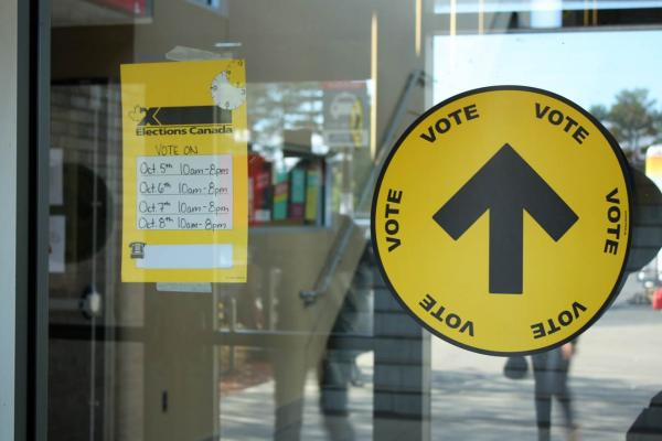 Picture of two voting information stickers on glass