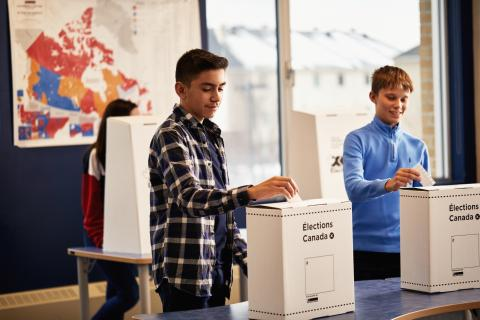 students voting in mock election