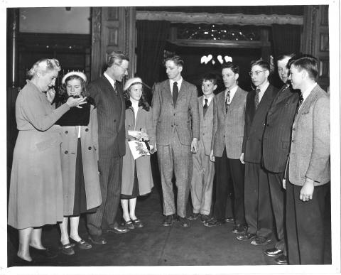 Black and white photograph showing a group of young people standing together with Agnes Macphail.