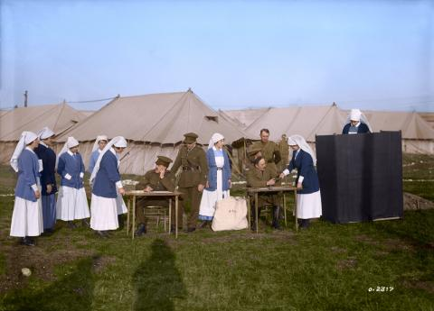 Photograph of a group of female military nurses lining up and voting outside during the First World War.