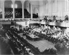 Black and white photo of the House of Commons Chamber during its opening ceremony.