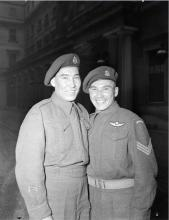 Black and white photo of Sergeant Tommy Prince (on the right), 1st Canadian Parachute Battalion, with his brother, Private Morris Prince, at an investiture at Buckingham Palace.