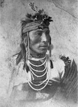 Black and white portrait of a First Nations man from the Plains.